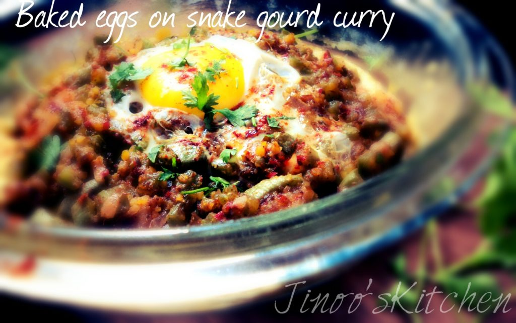 Baked eggs on spicy snake gourd curry